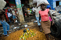 Haitian women carry food supplies in the La Saline market, Port-au-Prince, Haiti, 13 July 2008. Every day thousands of women from all over the city of Port-au-Prince try to resell supplies and food from questionable sources in the La Saline market. The informal sector significantly predominate within the poor Haitian economics and the regular shops virtually do not exist. La Saline is the largest street market area in Port-au-Prince.