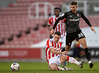 31st October 2020; Bet365 Stadium, Stoke, Staffordshire, England; English Football League Championship Football, Stoke City versus Rotherham United; Jordan Thompson of Stoke City passes the ball as he is tackled by Daniel Barlaser of Rotherham United