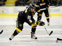 29 December 2007: University of Vermont Catamounts' forward Dean Strong, a Junior from Mississauga, Ontario, in action against the Holy Cross Crusaders at Gutterson Fieldhouse in Burlington, Vermont. The Catamounts rallied in the final seconds of play to tie the game 1-1. After overtime, although the official result remained a tie game, the Cats moved up to the championship round by winning a sudden death shootout in the second game of the Sheraton/TD Banknorth Catamount Cup Tournament...Mandatory Photo Credit: Ed Wolfstein Photo