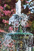 Close-up view of a flowing water fountain with fast shutter speed to freeze the flowing, bubbling waters.  Meek Estate Park, Hayward, California.