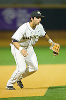 Third baseman Carlos Lopez #3 of the Wake Forest Demon Deacons on defense against the Charlotte 49ers at Gene Hooks Field on March 22, 2011 in Winston-Salem, North Carolina.   Photo by Brian Westerholt / Four Seam Images