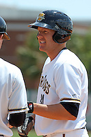 Luke Murton #34 of the Charleston RiverDogs on 1st base after hitting a single during a game against the Rome Braves on April 27, 2010 in Charleston, SC.