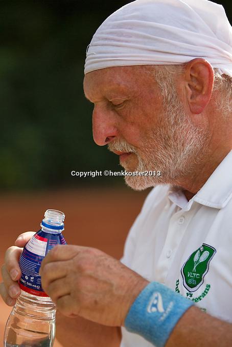 2013,August 21,Netherlands, Amstelveen,  TV de Kegel, Tennis, NVK 2013, National Veterans Tennis Championships, Drinking at changeover  <br /> Photo: Henk Koster