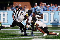 CHAPEL HILL, NC - SEPTEMBER 21: Antonio Williams #24 of the University of North Carolina is tackled by Trey Cobb #45 and Shaun Jolly #3 of Appalachian State University during a game between Appalachian State University and University of North Carolina at Kenan Memorial Stadium on September 21, 2019 in Chapel Hill, North Carolina.