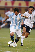 Argentina forward Sergio Aguero (11) and United States midfielder Pablo Mastroeni (25). The men's national teams of the United States and Argentina played to a 0-0 tie during an international friendly at Giants Stadium in East Rutherford, NJ, on June 8, 2008.