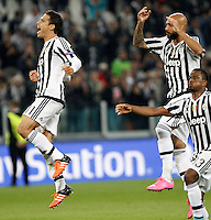 Calcio, Champions League: Gruppo D - Juventus vs Siviglia. Torino, Juventus Stadium, 30 settembre 2015.  <br /> From left, Juventus's Hernanes, Simone Zaza and Patrice Evra celebrate at the end of the Group D Champions League football match between Juventus and Sevilla at Turin's Juventus Stadium, 30 September 2015. Juventus won 2-0.<br /> UPDATE IMAGES PRESS/Isabella Bonotto