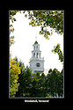 Foliage frames the iconic clock tower in Woodstock, Vermont.