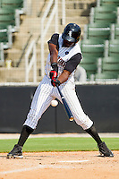 Kenny Gilbert #26 of the Kannapolis Intimidators connects with the baseball for a triple against the Hagerstown Suns at Fieldcrest Cannon Stadium on May 30, 2011 in Kannapolis, North Carolina.   Photo by Brian Westerholt / Four Seam Images