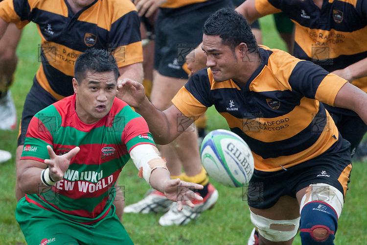 Notise Tauafoa gets the pass away before Kolo Vea can make the tackle. Counties Manukau Premier Club Rugby game between Bombay and Waiuku played up on the hill at Bombay on March 26th 2011. Waiuku won 57 - 10 after leading 24 - 3 at halftime.