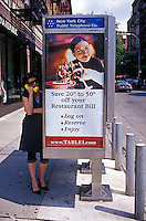 Woman talking on pay telephone<br />