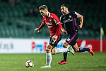 Muangthong United Forward Xisco Jimenez (l) is chased by Rufino Segovia of SC Kitchee (r) during the 2017 Lunar New Year Cup match between SC Kitchee (HKG) vs Muangthong United (THA) on January 28, 2017 in Hong Kong, Hong Kong. Photo by Marcio Rodrigo Machado/Power Sport Images