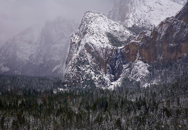 Snow has fallen on Yosemite Valley's Bridalveil Falls at Yosemite National Park, California