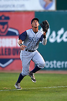 Brooklyn Cyclones outfielder Oswald Caraballo (9) tracks a fly ball during the first game of a doubleheader against the Connecticut Tigers on September 2, 2015 at Senator Thomas J. Dodd Memorial Stadium in Norwich, Connecticut.  Brooklyn defeated Connecticut 7-1.  (Mike Janes/Four Seam Images)