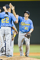 Nick Vickerson (21) of the Myrtle Beach Pelicans high fives teammates after their win over the Winston-Salem Dash at BB&T Ballpark on July 16, 2014 in Winston-Salem, North Carolina.  The Pelicans defeated the Dash 6-2.   (Brian Westerholt/Four Seam Images)