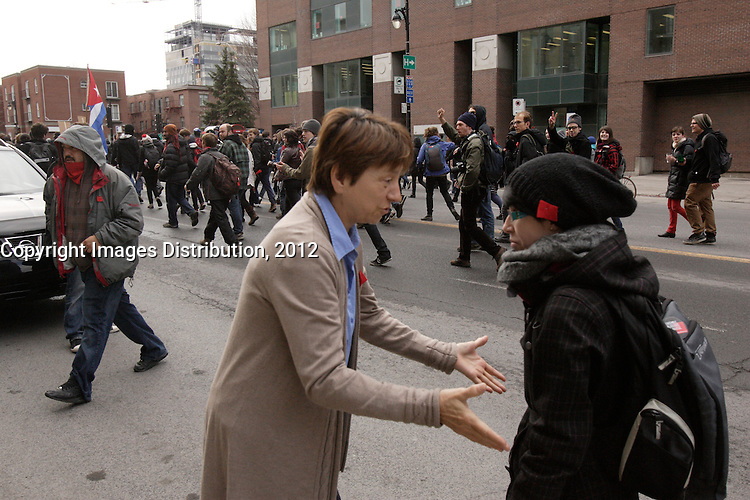 Montreal (QC) CANADA - April 11 2012 - Quebec students on strike againt tuition fee walk on Berri street near UQAM University, where they are joined by Quebec Solidaire co-leaders : Amir Khadir and Francoise David