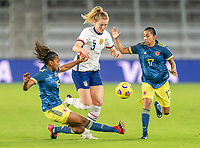 ORLANDO, FL - JANUARY 22: Jorelyn Carabalí #16 tries to tackle Samantha Mewis #3 of the USWNT during a game between Colombia and USWNT at Exploria stadium on January 22, 2021 in Orlando, Florida.