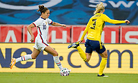 SOLNA, SWEDEN - APRIL 10: Carli Lloyd #10 of the United States moves with the ball during a game between Sweden and USWNT at Friends Arena on April 10, 2021 in Solna, Sweden.
