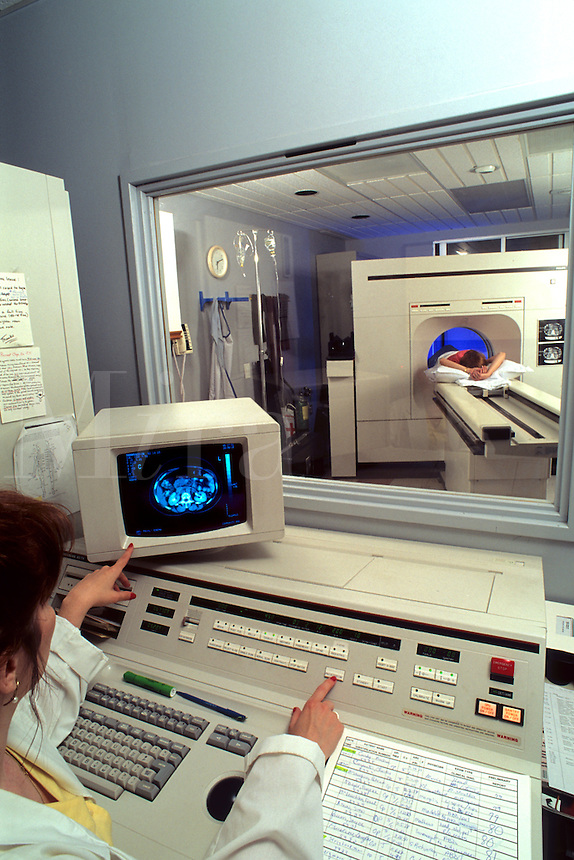 Medical professional administering cat scan on patient