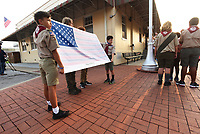 Boy Scouts from Troop 36 in Bentonville Caden Dancer (from left), Benji Wessels (cq), Tristan Browning and Jack Hudson present Saturday Sept. 11 2021 the 9-11 Flag of  Honor during the 9-11 remembrance ceremony on the Bentonville square. Go to nwaonline.com/210912Daily to see more photos.<br /> (NWA Democrat-Gazette/Flip Putthoff)