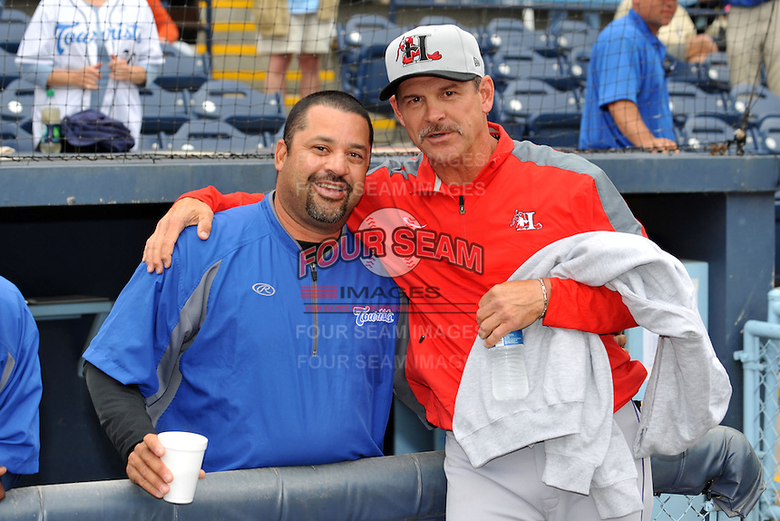 Former Asheville Tourists manager and current Texas Rangers roving instructor Joe Mikuliks with Tourists manager Fred Ocasio #28 before a game between the Hickory Crawdads and the Asheville Tourists at McCormick Field on April 17, 2013 in Asheville, North Carolina. The Crawdads won the game 6-5. (Tony Farlow/Four Seam Images).