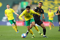 20th April 2021; Carrow Road, Norwich, Norfolk, England, English Football League Championship Football, Norwich versus Watford; Andrew Omobamidele of Norwich City under pressure from João Pedro of Watford