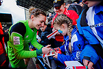 Liverpool Ladies 2 Everton Ladies 1, 19/03/2017. Select Security Stadium, SSE FA Cup Fifth Round. Liverpool's Siobhan Chamberlain signs an autograph for an Everton fan after the game between Liverpool Ladies v Everton Ladies at The Select Security Stadium, Widnes, in the Women's SSE FA Cup Fifth Round. Photo by Paul Thompson.