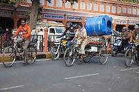 Jaipur, Rajasthan, India.  Street Traffic; Rickshaw Carrying Construction Materials.