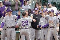 The TCU Horned Frog bench celebrates scoring against the Texas Tech Red Raiders on Friday March 5th, 2100 at the Astros College Classic in Houston's Minute Maid Park.  (Photo by Andrew Woolley / Four Seam Images)
