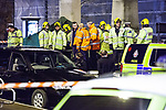 © Joel Goodman - 07973 332324 .16/12/2011 . Manchester , UK . Police, firefighters and paramedics attend St Peter's Square tram stop in central Manchester after an accident in which a man , identified as Gary Thompson , falls to his death under a tram . Photo credit: Joel Goodman