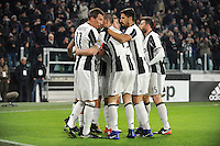 Calcio, quarti di finale di Tim Cup: Juventus vs Milan. Torino, Juventus Stadium, 25 gennaio 2017.<br /> Juventus' Paulo Dybala is hidden by teammates' hugs after scoring during the Italian Cup quarter finals football match between Juventus and AC Milan at Turin's Juventus stadium, 25 January 2017.<br /> UPDATE IMAGES PRESS/Manuela Viganti