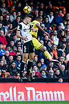 Gabriel Armando De Abreu of Valencia CF (L) fights for the ball with Cedric Bakambu of Villarreal CF (R)  during the La Liga 2017-18 match between Valencia CF and Villarreal CF at Estadio de Mestalla on 23 December 2017 in Valencia, Spain. Photo by Maria Jose Segovia Carmona / Power Sport Images