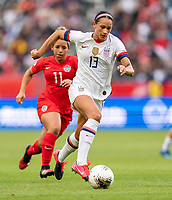 CARSON, CA - FEBRUARY 9: Lynn Williams #13 of the United States dribbles during a game between Canada and USWNT at Dignity Health Sports Park on February 9, 2020 in Carson, California.