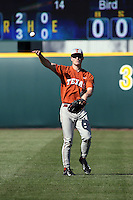 Brady Harlan (8) of the Texas Longhorns throws between innings of a game against the UCLA Bruins at Jackie Robinson Stadium on March 12, 2016 in Los Angeles, California. UCLA defeated Texas, 5-4. (Larry Goren/Four Seam Images)