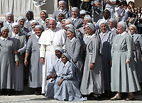 Papa Francesco saluta un gruppo di suore al termine dell'udienza generale del mercoledi' in Piazza San Pietro, Citta' del Vaticano 25 settembre 2019.<br /> Pope Francis greets nuns at the end of the weekly general audience in St. Peter's Square at the Vatican, on September 25, 2019.<br /> UPDATE IMAGES PRESS/Isabella Bonotto<br /> <br /> STRICTLY ONLY FOR EDITORIAL USE
