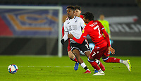 30th December 2020; Liberty Stadium, Swansea, Glamorgan, Wales; English Football League Championship Football, Swansea City versus Reading; Jamal Lowe of Swansea City passes the ball while under pressure from Tom Holmes of Reading FC