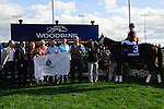 I'm Boundtoscore, with jockey Sarah Rook in the Winners Circle at Woodbine Race Course in Ontario, Canada on September 15, 2012.