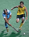 DELHI, INDIA - OCTOBER 07: Jason Wilson of Australia battles with Sardar Singh of India  India in the mens hockey match at Major Dhyan Chand Stadium during day four of the Delhi 2010 Commonwealth Games on October 7, 2010 in Delhi, India.  (Photo by Graham Crouch/Getty Images) *** Local Caption *** Jason Wilson; Sardar Singh