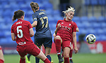 Niamh Fahey of Liverpool Ladies and Laura Coombs of Liverpool Ladies take the ball off Lizzie Arnot of Manchester United Women