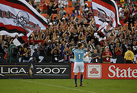 DC United goal keeper Troy Perkins thanking the fans for their support after the victory. DC United defeated Club America 1-0 to secure one of the two semifinal berths in SuperLiga group B, at RFK Stadium in Washington DC, Sunday July 29, 2007.