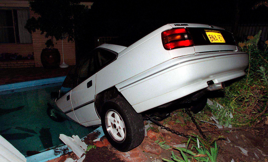 A car in lands in a swimming pool at rear of house in Perth, after failing to take a bend.