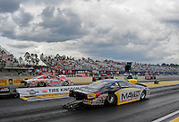 Mar. 9, 2012; Gainesville, FL, USA; NHRA pro stock driver Rodger Brogdon (near lane) races alongside Greg Anderson during qualifying for the Gatornationals at Auto Plus Raceway at Gainesville. Mandatory Credit: Mark J. Rebilas-