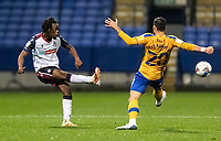 Bolton Wanderers' Peter Kioso (left) crosses under pressure from Mansfield Town's Stephen McLaughlin<br /> <br /> Photographer Andrew Kearns/CameraSport<br /> <br /> The EFL Sky Bet League Two - Bolton Wanderers v Mansfield Town - Tuesday 3rd November 2020 - University of Bolton Stadium - Bolton<br /> <br /> World Copyright © 2020 CameraSport. All rights reserved. 43 Linden Ave. Countesthorpe. Leicester. England. LE8 5PG - Tel: +44 (0) 116 277 4147 - admin@camerasport.com - www.camerasport.com