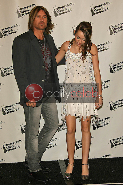 illy Ray Cyrus and Miley Cyrus<br />in the press room at the 34th Annual American Music Awards. Shrine Auditorium, Los Angeles, CA. 11-21-06<br />Dave Edwards/DailyCeleb.com 818-249-4998