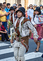 Lima, Peru.  Young Man Marching in an Andean Cultural Parade, Plaza de Armas.