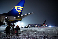 Pictured: Passengers disembark a RyanAir flight on the snow covered Macedonia Airport in Salonica, northern Greece in the early hours of the morning. Thursday 12 January 2017<br />Re: Heavy snow has affected most parts of Greece.