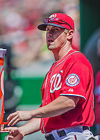 31 May 2014: Washington Nationals outfielder Tyler Moore gets water in the dugout during a game against the Texas Rangers at Nationals Park in Washington, DC. The Nationals defeated the Rangers 10-2, notching a second win of their 3-game inter-league series. Mandatory Credit: Ed Wolfstein Photo *** RAW (NEF) Image File Available ***