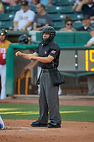 Umpire Jonathan Parra handles the calls behind the plate during the game between the Salt Lake Bees and the Oklahoma City Dodgers at Smith's Ballpark on August 1, 2019 in Salt Lake City, Utah. The Bees defeated the Dodgers 14-4. (Stephen Smith/Four Seam Images)