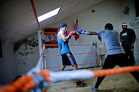 """"""" At first, I was more attracted by the kickboxing, but finally the technique of the boxing seduced me """", explains enthusiastic Mohamed Boujazia, age 19. He trains for only two months, but already makes figure of young hope of the club."""
