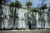 Belem, Brazil. Navy Arsenal - Arsenal de Marinha, 4th Naval District. Smart refurbished Colonial style building with palm trees in front.