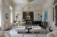 The drawing room of an elegant family townhouse in Paris with a view through to the study. Design by Bryan O'Sullivan.